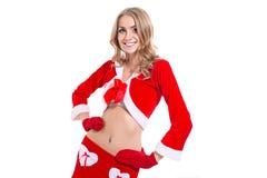 愉快的微笑的妇女在圣诞老人衣裳 免版税库存图片