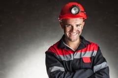 愉快的微笑的煤矿工人画象  免版税库存图片