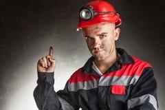 愉快的微笑的煤矿工人画象  库存图片