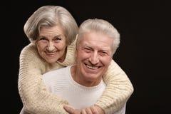愉快的微笑的老夫妇 免版税库存照片