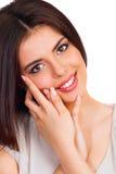 愉快的微笑的年轻美丽的妇女画象  免版税图库摄影