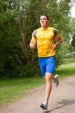 愉快的慢跑者年轻人 库存照片