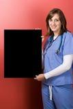 愉快的护士符号 免版税库存图片