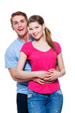 愉快的拥抱夫妇画象  库存图片