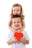 愉快的拥抱的孩子 免版税图库摄影