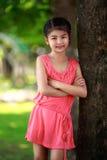 愉快的新亚裔女孩 免版税库存图片