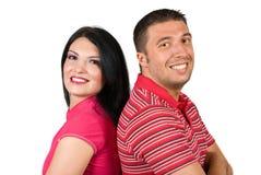 愉快的新夫妇纵向在粉红色的 免版税库存图片