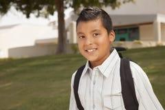 愉快的新西班牙男孩准备好学校 免版税图库摄影