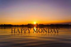 `愉快的星期一`用日落水,暮色时间 图库摄影