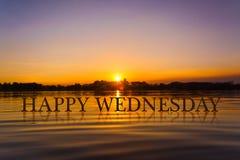 `愉快的星期三`用日落水,暮色时间 免版税库存图片