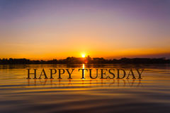 `愉快的星期二`用日落水,暮色时间 免版税图库摄影