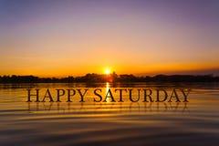 `愉快的星期六`用日落水,暮色时间 免版税图库摄影