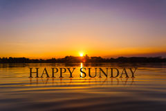 `愉快的星期天`用日落水,暮色时间 图库摄影