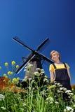 愉快的村庄风车妇女 图库摄影