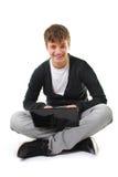 愉快的查出的膝上型计算机少年 免版税库存照片
