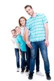 愉快的欧洲家庭的充分的画象有孩子的 免版税库存照片