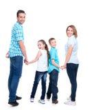 愉快的欧洲家庭的充分的画象有孩子的 库存照片