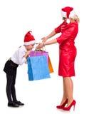 愉快的母亲和女儿圣诞老人帽子的 库存图片