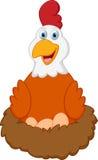 愉快的母鸡动画片用在巢的鸡蛋 免版税库存图片