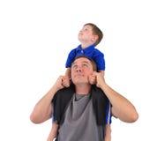 愉快的父亲和儿子一起在白色 免版税图库摄影