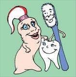 愉快的牙牙膏和牙刷家庭 免版税库存照片