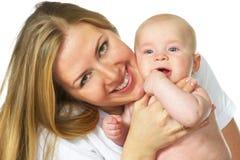 愉快的男婴她的母亲年轻人 免版税库存图片