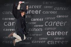 愉快的男学生的综合图象毕业生长袍跳跃的 图库摄影