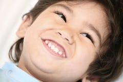 愉快的男孩微笑的一点 库存图片
