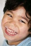 愉快的男孩微笑的一点 免版税库存图片