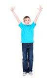 愉快的男孩用被举的手 免版税图库摄影