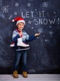 愉快的男孩-让它下雪 免版税库存照片