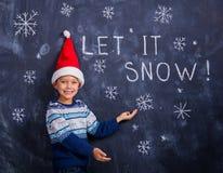 愉快的男孩-让它下雪 免版税图库摄影