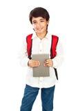 愉快的男小学生 免版税图库摄影