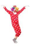 愉快的男性小丑跳舞 免版税库存照片