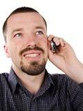 愉快的男性移动电话联系 库存图片