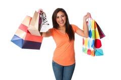 愉快的疯狂购物妇女年轻人 免版税库存照片