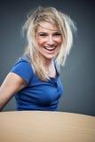愉快的白肤金发的女性 库存照片
