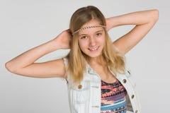 愉快的白肤金发的青少年的女孩 图库摄影