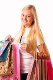 愉快的白肤金发的购物妇女 库存图片