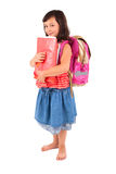 愉快的矮小的女小学生 库存照片