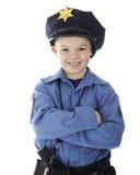 愉快的矮小的警察 免版税库存图片