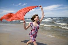 愉快的红色围巾少年 免版税图库摄影
