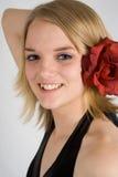 愉快的红色玫瑰色少年 免版税库存照片