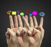愉快的组手指面带笑容 免版税库存图片