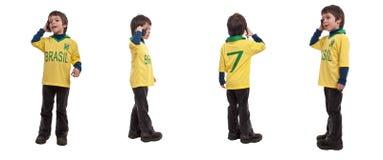 愉快的英俊的小男孩谈话在电话- la拼贴画  库存照片