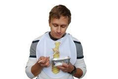 愉快的英俊的食人的快餐饺子 库存图片