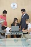 愉快的董事在会议在办公室 免版税库存图片