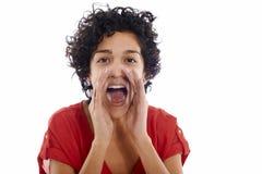 愉快的西班牙妇女叫喊对照相机 免版税库存照片