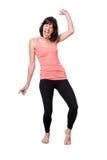 愉快的赤足少妇跳舞 免版税库存图片