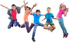 愉快的跳舞跳跃的孩子被隔绝在白色背景 库存图片